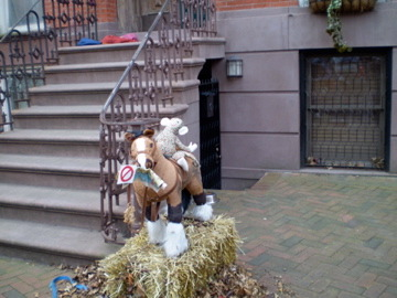 Spencer, the Horse on Straw Bale with Leaves